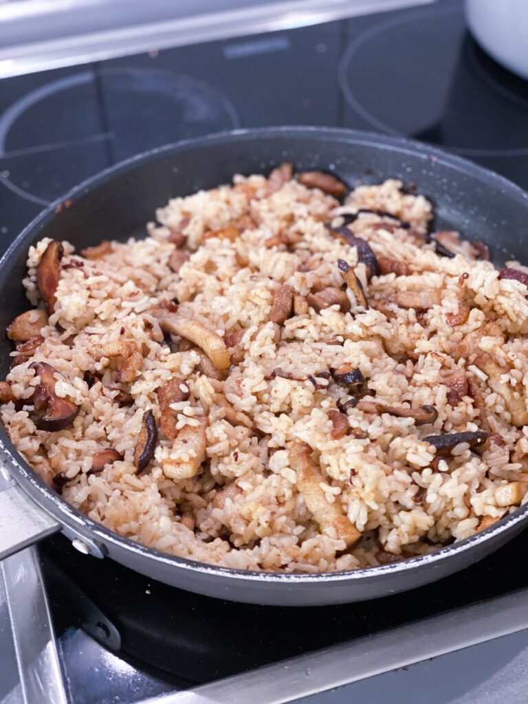 chinese sticky rice cooking in pan